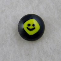 Handmade Fused Glass Tie Tacks with Yellow Smiley Face on a Black glass base