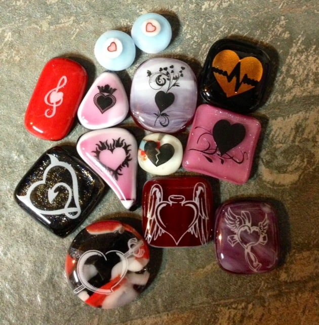 A variety of fused glass cabochons that can be made into pendants, brooches, key chains etc.