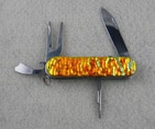 Fused Glass , Multi-functional golf tool and knife tool. Stainless Steel. Fire Red Dichroic glass. With amazing texture and color.