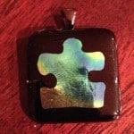 Puzzle Pendant representing Autism Awareness.